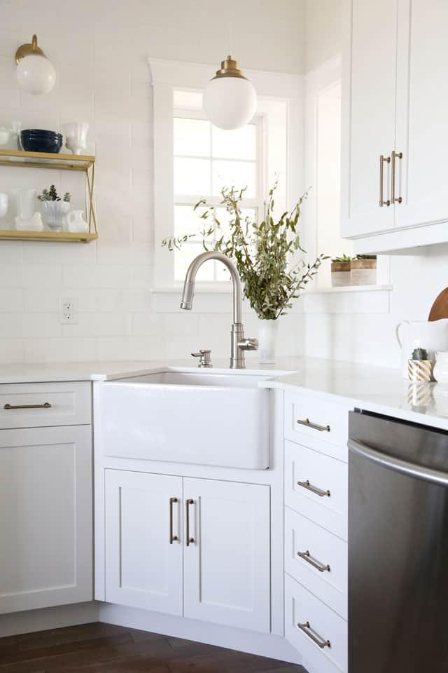 Modern farmhouse kitchen with navy island