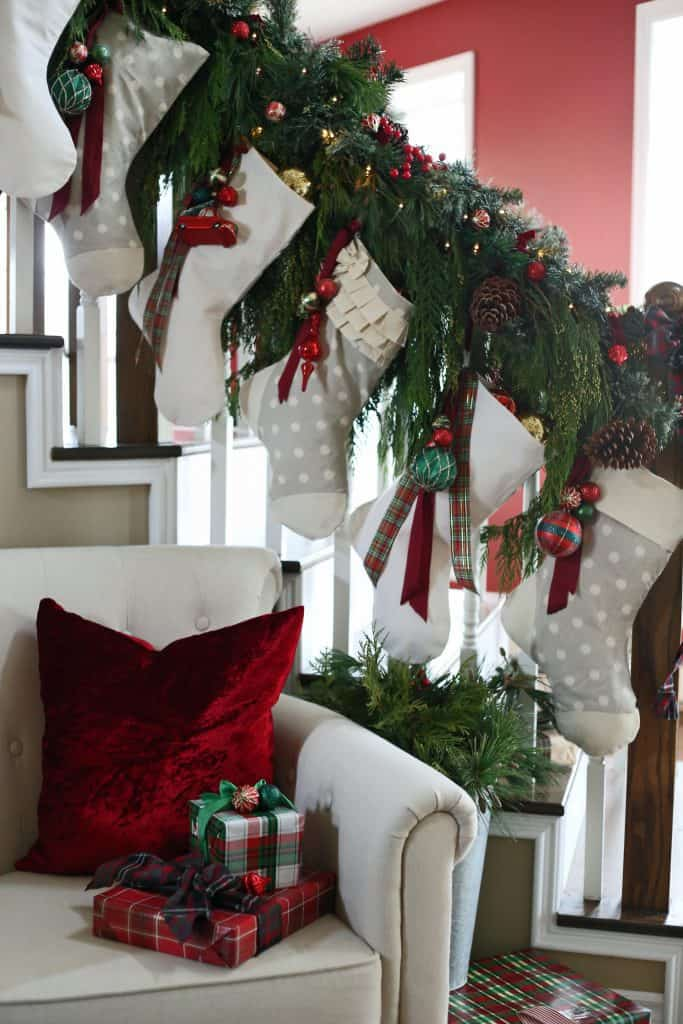 Decorated banister for Christmas with real boughs