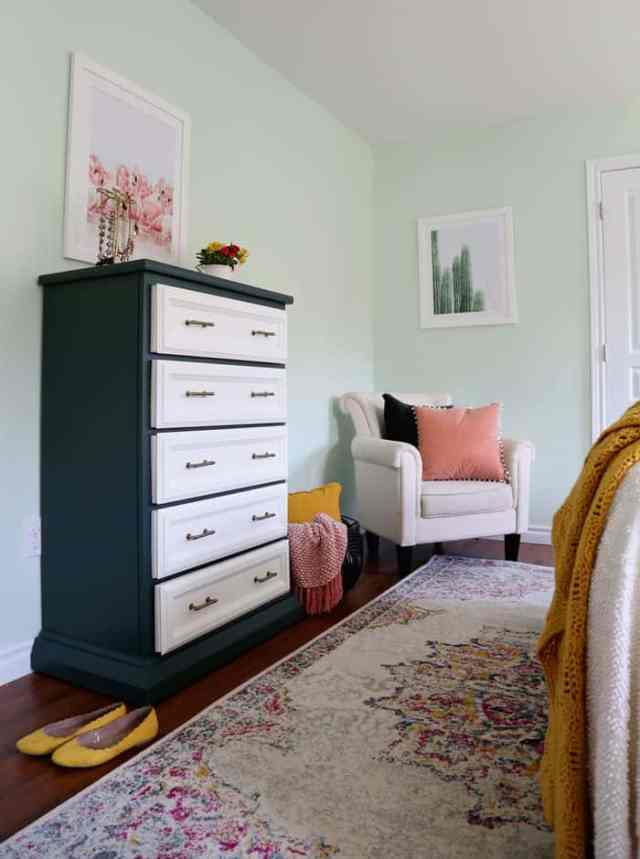 Green and white dresser with Champagne bronze hardware | Bright and Colourful Master Bedroom refresh | Colorful Master Bedroom Refresh by popular home decor blog, FYN Designs: image of a bright and colorful master bedroom with a Hudson Valley Duchess pendant light, floral bedding, and D. Lawless hardware Champagne Bronze Francisco Pulls.