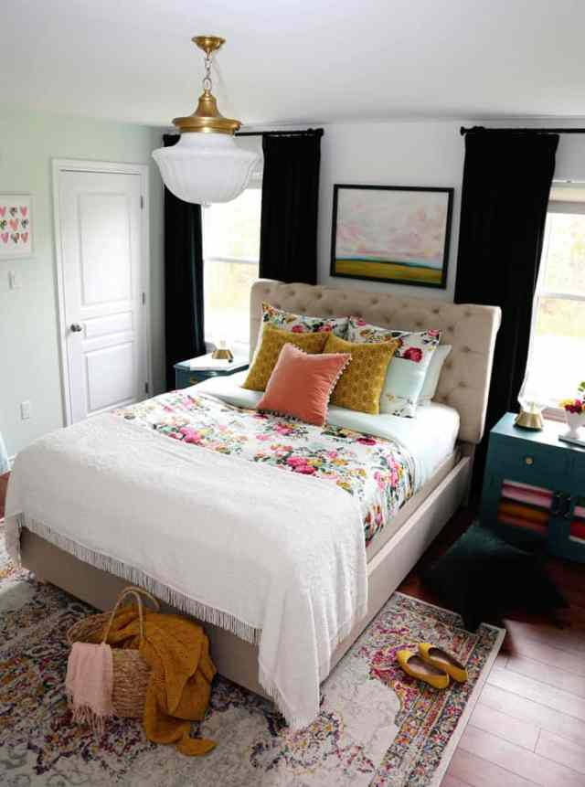 Bright and Colourful Master Bedroom refresh | Colorful Master Bedroom Refresh by popular home decor blog, FYN Designs: image of a bright and colorful master bedroom with a Hudson Valley Duchess pendant light, floral bedding, and D. Lawless hardware Champagne Bronze Francisco Pulls.