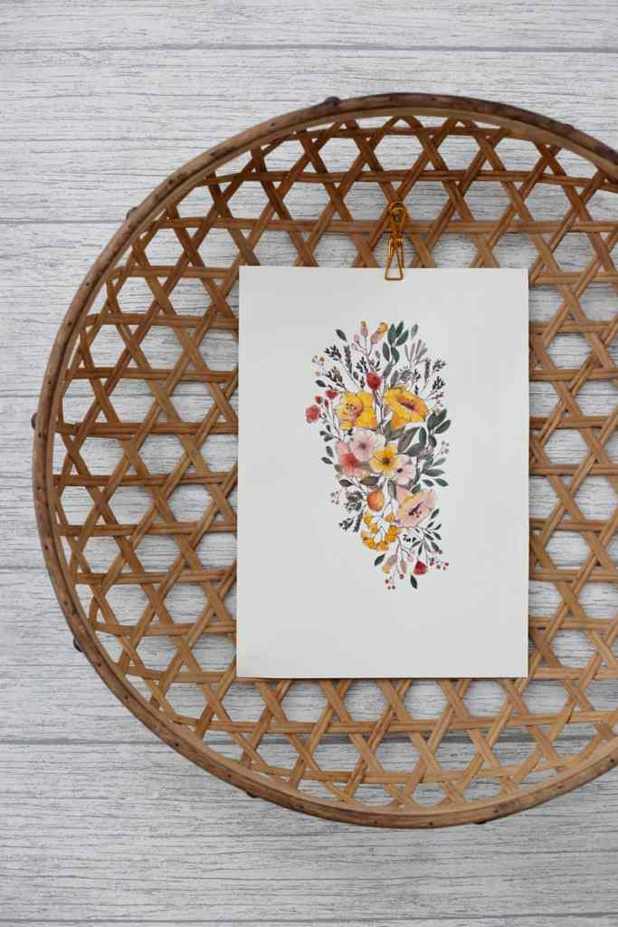 Free wildflower watercolor printables. Set of 4 printables to print on watercolor paper on your home printer. | How to Print on Watercolor Paper by popular US interior design blog, Fynes Designs: image of a wildflower printable clipped to the inside of a wicker basket.