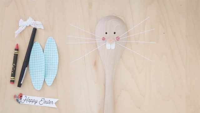 Easter Bunny Crafts: How to Make a Cute Wooden Spoon Easter Bunny, a tutorial featured by top craft blog, Fynes Designs: Hot glue the whiskers in place | Easter Bunny Crafts by popular interior design blog, Fynes Designs: image of a wooden spoon with a Easter Bunny face on it.