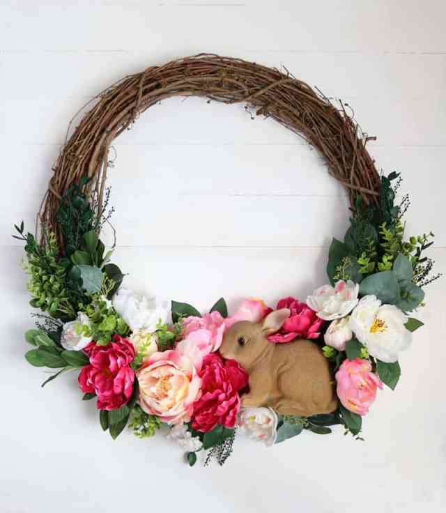 Bunny rabbit spring wreath | Easy Spring Wreath Idea by popular interior design blog, Fynes Designs: image of a DIY bunny rabbit and floral wreath.