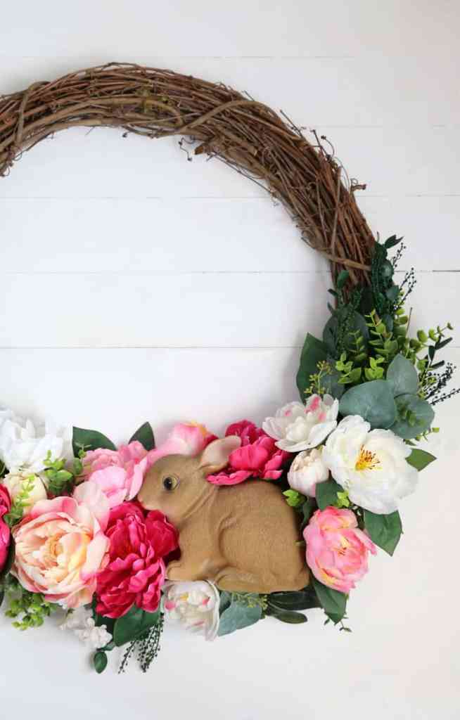 How to Put a Garden Bunny on a Spring Wreath for your Front Door | Easy Spring Wreath Idea by popular interior design blog, Fynes Designs: image of a DIY bunny rabbit and floral wreath.