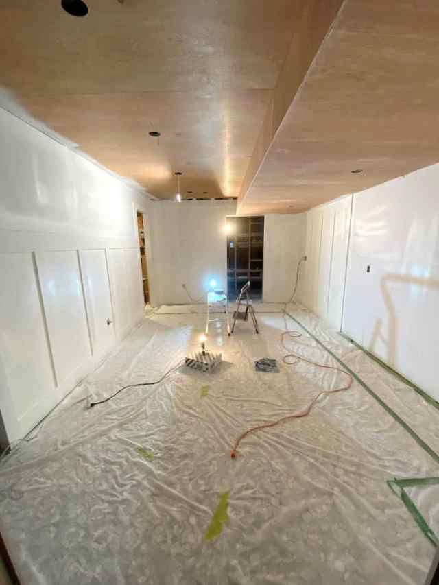 painted basement room  | Jeffrey Court by popular US interior design blog, Fynes Designs: image of a basement with a white board and batten wall.