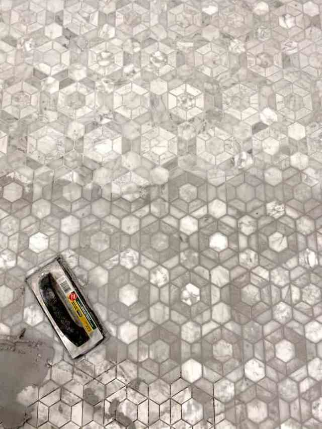 Grouting the Bronson tile from Jeffrey Court Tile | Jeffrey Court by popular US interior design blog, Fynes Designs: image of grouting Jeffrey Court Bronson tile.