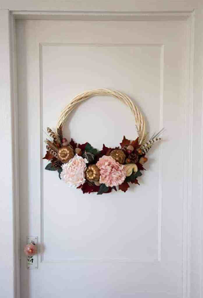 Follow this Fall wreath tutorial to create a pretty decoration for your front door |  Fall Wreath by popular Canada DIY blog, Fynes Designs: image of a fall wreath hanging on a bedroom door.