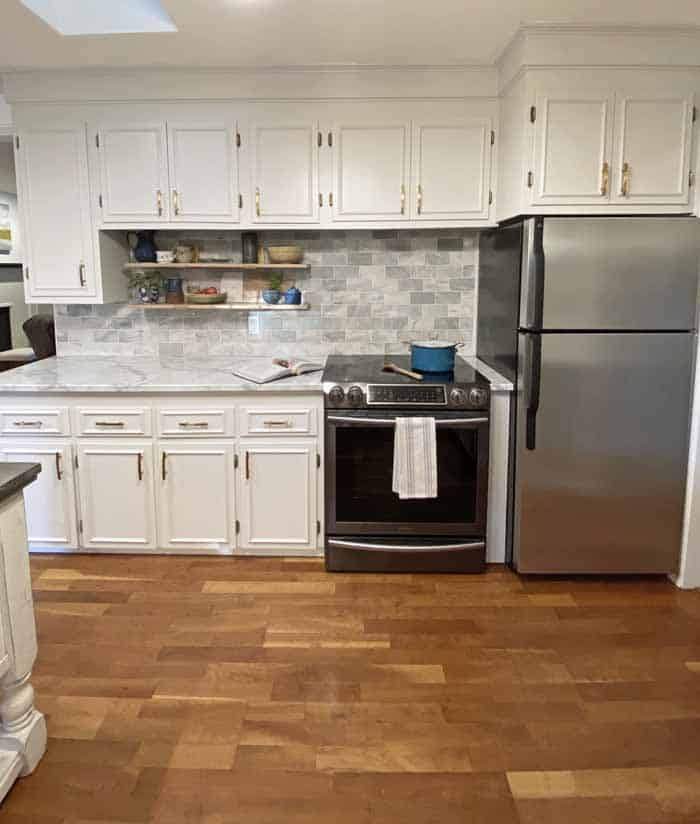 Rearranging the appliances in a 90's kitchen remodel | Kitchen remodel before and after by popular Canada DIY blog, Fynes Designs: after image of a 90's kitchen with a marble tile back splash, marble counter tops, marble cabinets, and bloating shelves.