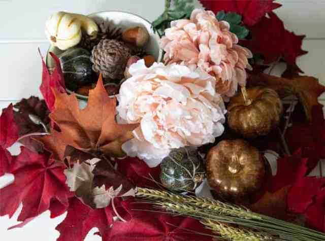 Fall wreath making supplies |  Fall Wreath by popular Canada DIY blog, Fynes Designs: image of faux leaves, faux flowers, foam pumpkins, and foam acorns.