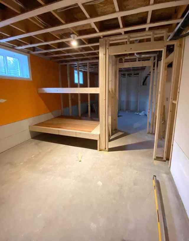 Vinyl Plank Flooring by popular Canada interior design blog, Fynes Designs: image of a unfinished basement.