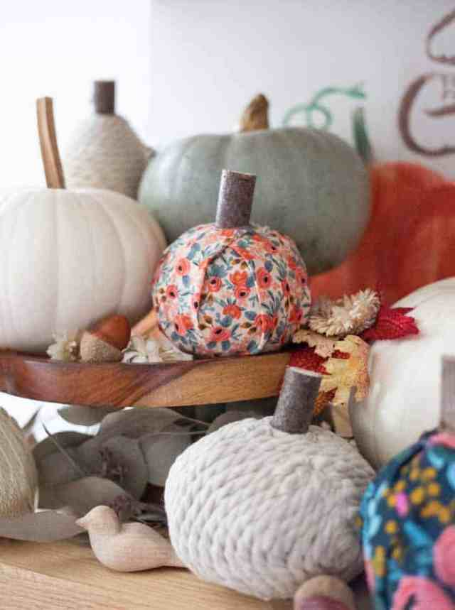 How to make pretty fabric covered pumpkins |Fabric Pumpkins by popular Canada craft blog, Fynes Designs: image of various no-sew fabric pumpkins.