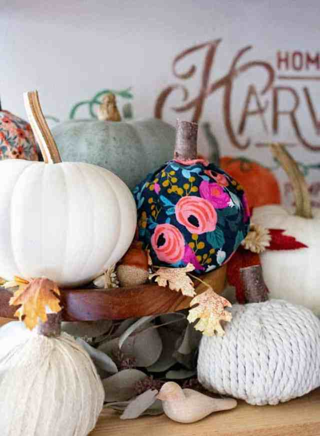 How to make pretty fabric pumpkins. Watch the video to see how easy! | Fabric Pumpkins by popular Canada craft blog, Fynes Designs: image of various no-sew fabric pumpkins.