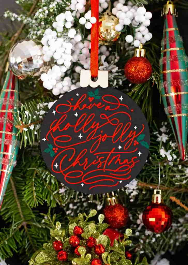Free Christmas SVG file for Silhouette and Cricut | SVG Files by popular Canada DIY blog, Fynes Designs: image of black and red ornament.