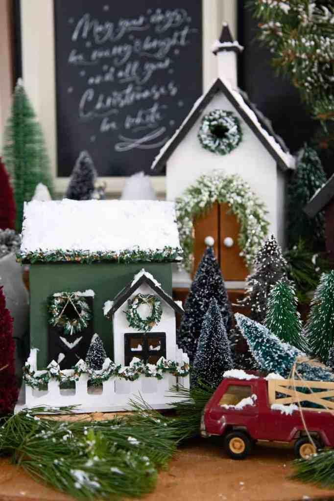 How to make a Joanna Gaines style Christmas Village |Christmas Village by popular Canada DIY blog, Fynes Designs: image of a farmhouse Christmas village.