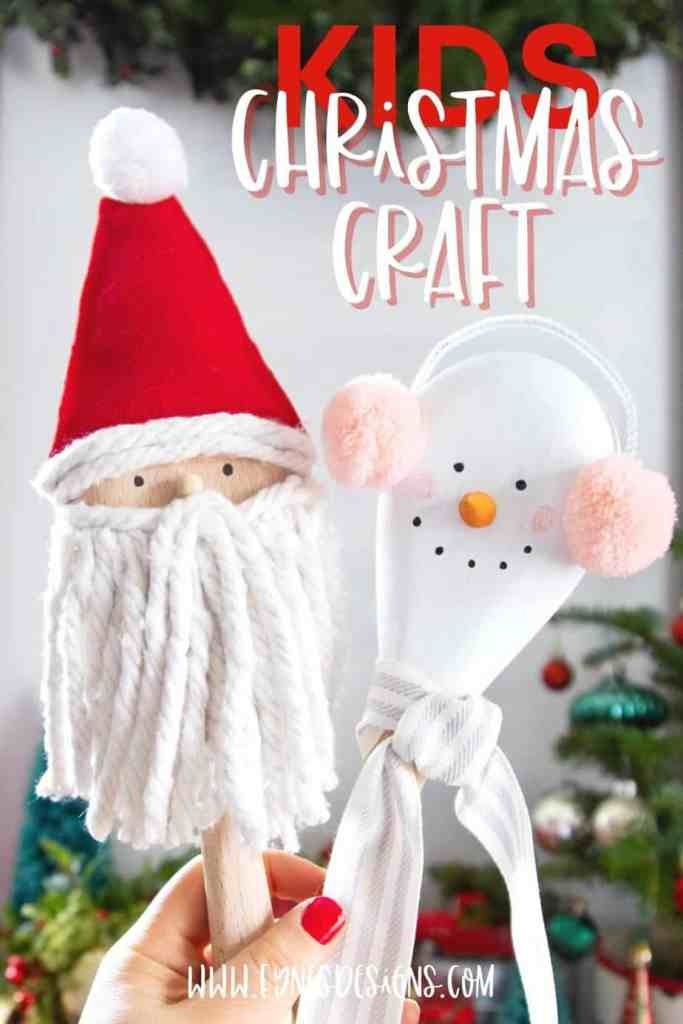 Kids Christmas Crafts: Wooden spoon Santa and Snowman | Kids Christmas Crafts by popular Canada DIY blog, Fynes Designs: image of a woman holding a Santa and Snowman wooden spoons.