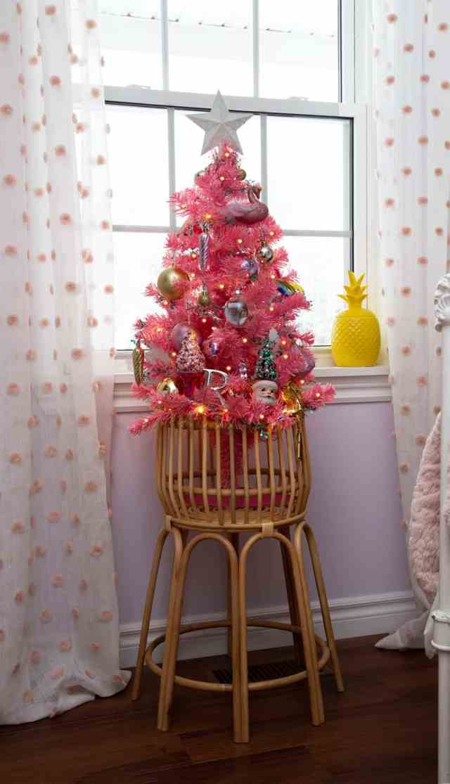 Pink kids Christmas tree |Colorful Christmas Decorations by popular Canada Interior Design blog, Fynes Designs: image of a girls bedroom with a mini pink Christmas tree.