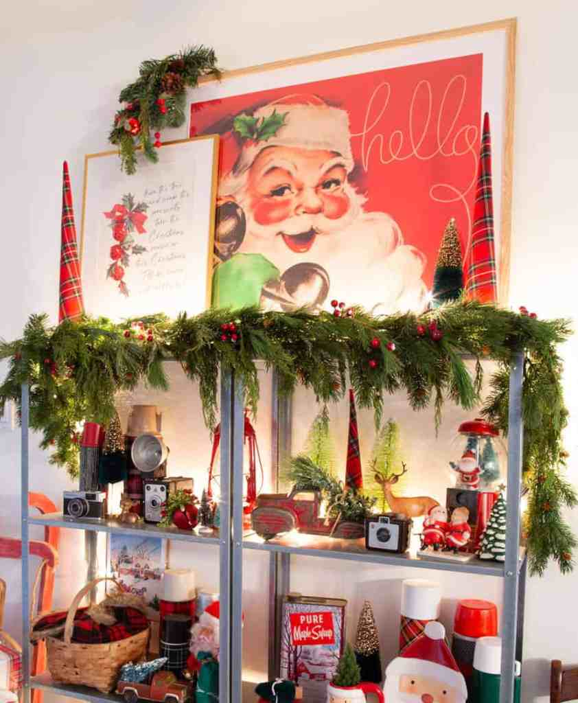 Hello Santa print from Collected and Curated |How to Hang Garland by popular Canada DIY blog, Fynes Designs: image of garland hanging on a shelf decorated with various Christmas decor items.