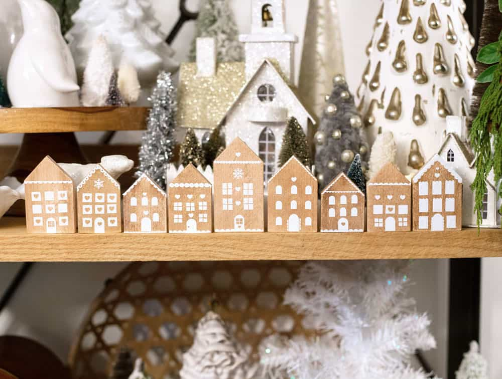Gingerbread house wood ornament DIY with a free SVG file |Wood Ornaments by popular Canada DIY blog, Fynes Designs: image of wooden gingerbread house ornaments.