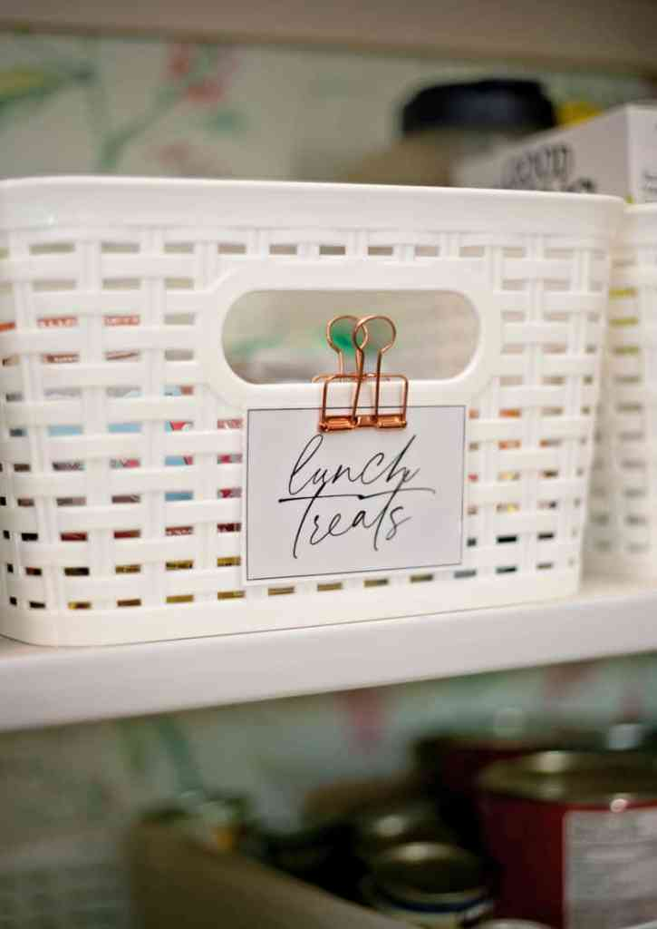 Free Modern Pantry Bin Labels |Pantry Organization Tips by popular Canada interior design blog, Fynes Designs: image of a white basket with a modern label attached to it.