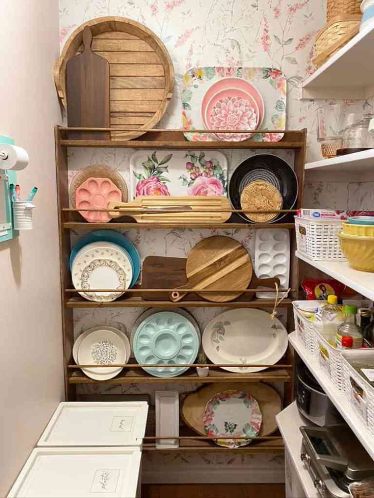 Organize the pantry with a plate wall to hold large platters |Pantry Organization Tips by popular Canada interior design blog, Fynes Designs: image of a organized plate wall in a walk-in pantry.
