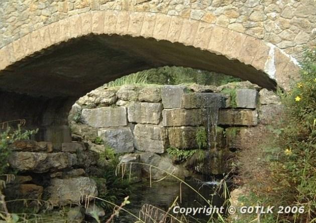 Stone bridge and mini waterfall