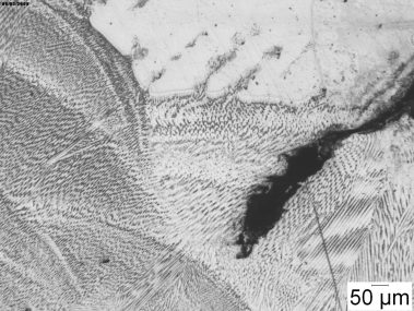 Weld testing by metallography and microscopy, showing a seam crack at 50X magnification