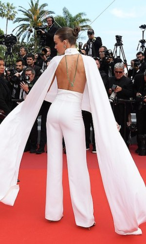 josephine skriver at the 2019 cannes film festival red carpet, white jumpsuit