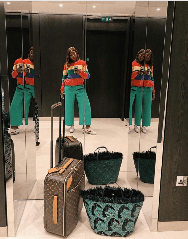 temi otedola with her louis vuitton travelling bag-min