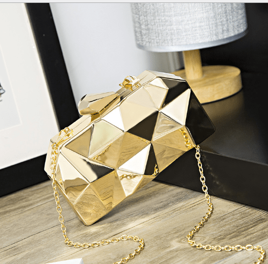 gold clutch purse angled view