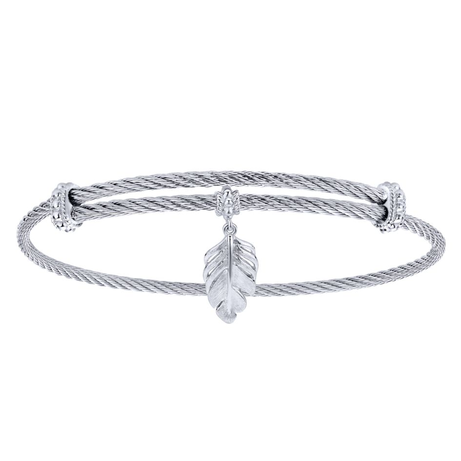 A delicate feather charm adorns this silver and stainless-steel cable bracelet