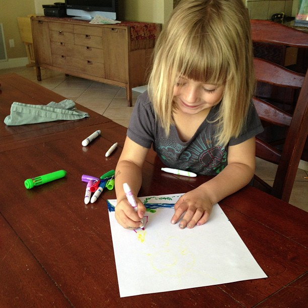 Emily drawing Rachel and Mark's new house on Hawaii