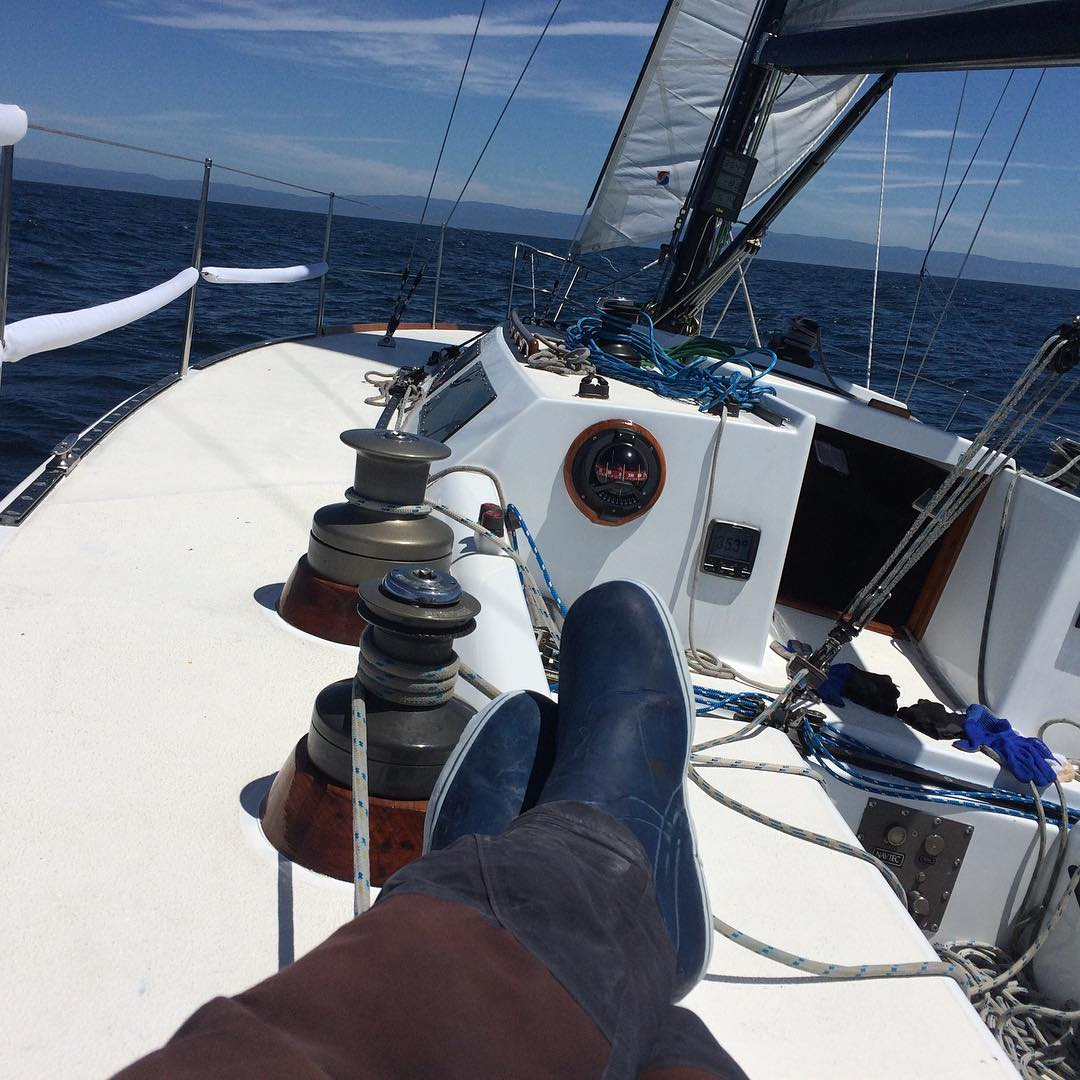 Making 5+ knots under sail with a perfect 12 knots of breeze to Santa Cruz. Shawn is taking a well deserved rest.