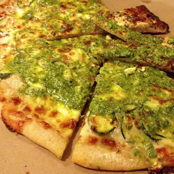 What everyone is waiting for - zucchini, onions, French feta cheese, mozzarella, basil pesto and pine nuts. $10 for 1/2 pizza.