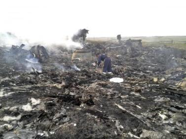 Emergencies Ministry member works at the site of a Malaysia Airlines Boeing 777 plane crash in the settlement of Grabovo in the Donetsk region