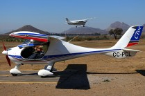 Flight Design CT SW CC-PCL preparing for start-up with Cessna 182 CC-KKD taking off on the background (photo: Carlos Ay).