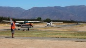 """Riders formation returning"": Los Andes Air Club Cessnas CC-PKQ, CC-PJL and CC-KAD taxiing back to the boarding area (photo: Carlos Ay)."