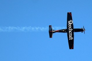 Exploiting its participation in FIDAE 2014's air displays, Beechcraft exploited T-6C Texan demonstrator's upper and lower wing surface as an effective brand-positioning billboard (photo: Carlos Ay).