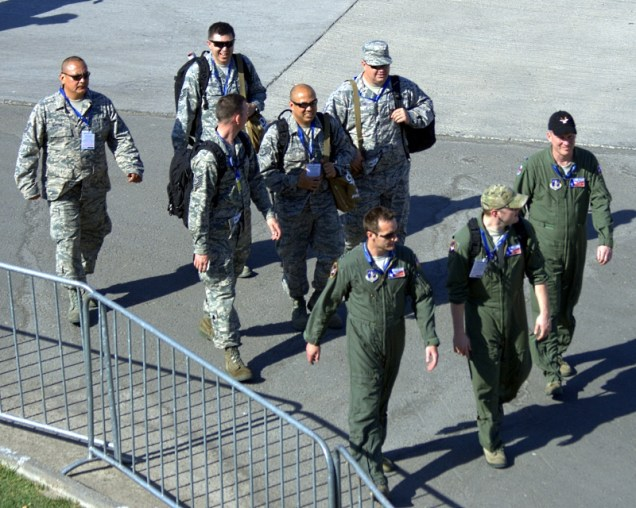 Three Texas Air Guard pilots and five of their flight-line mechanics approaching FIDAE 2014's control tower (photo: Fernando Puppio).