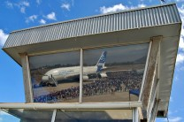 Airbus A380 F-WWOW and the public reflecting in Pudahuel's military control tower windows (photo: Michel Anciaux).