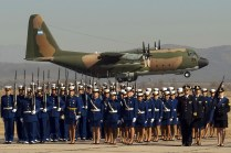 A classical postcard image of a recent-time Air Force Day ceremony shows Air Force High School cadets, NCOs and officers forming on the ground as C-130H Hercules TC-61 takes off from Córdoba's aviation school for the Centennial air parade in August 2012 (photo: José Luis Ghezzi).