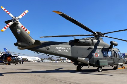Three-quarter rear view and mid-afternoon sun highlight AW139M's aerodynamic lines and rescue hoist (photo: Carlos Ay).