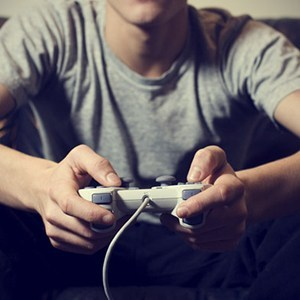 guy-with-joystick-playing-video-games-1