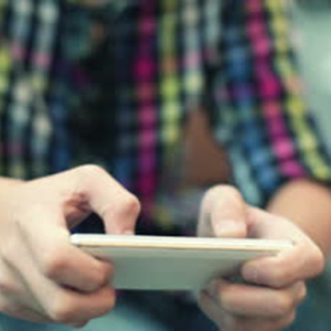 stock-footage-young-teenager-playing-game-on-smartphone
