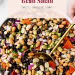 Bean salad with herbs, red onion, and other ingredients.