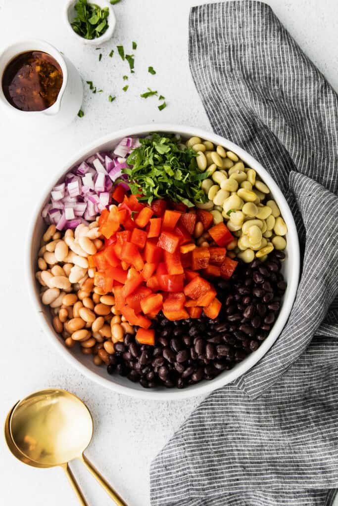 All the ingredients for bean salad in a bowl.