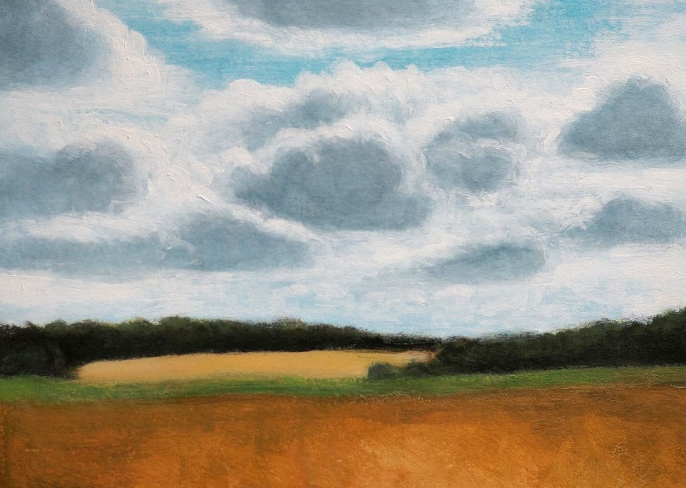 Clouds over field by Kendra Gadzala