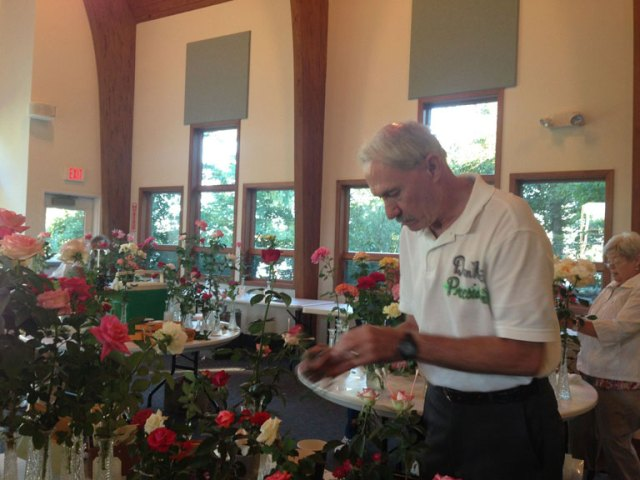 Dan Keil, Stephen F. Decatur Rose Society President preparing for the show