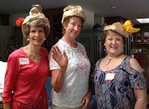 women wearing paper hats