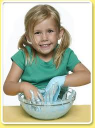 girl playing with blue goo