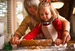 Woman baking with granddaughter